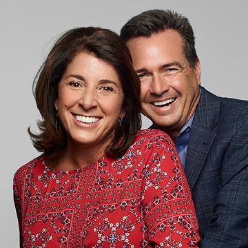 Man and woman. Man hugging woman smiling at camera.
