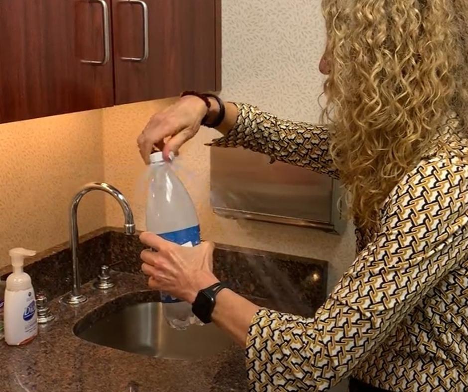 Mollie Sugarman opening a shaken bottle of soda