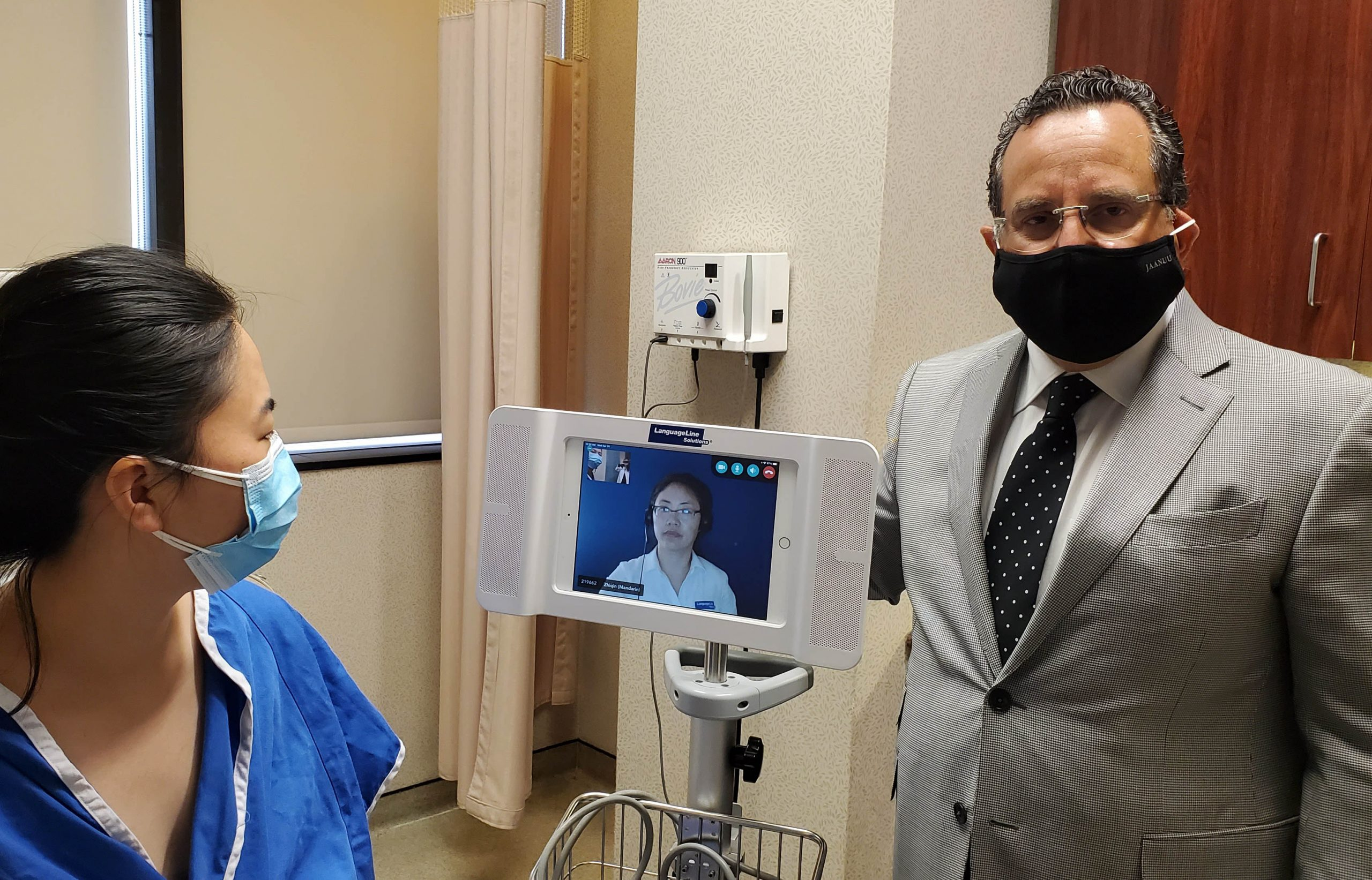 Dr. Feingold with LanguageLine Translator Machine and Patient