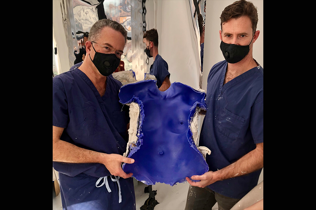 Dr. Israeli and Dr. Bank hold a completed molding of life cast and looking at camera.