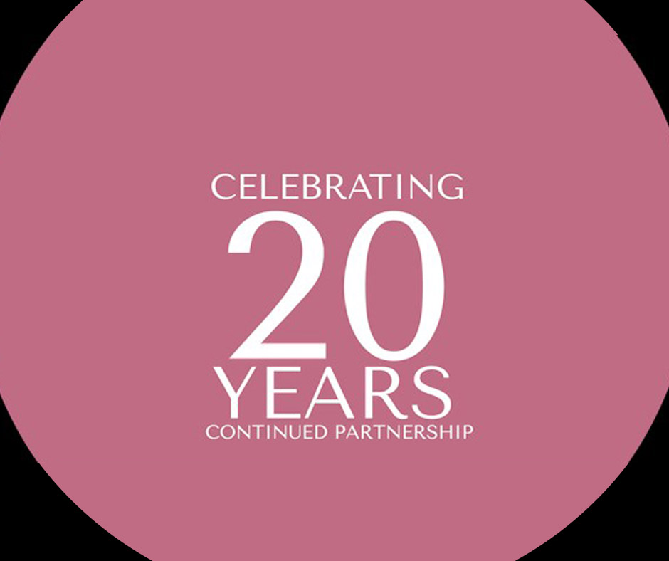 Pink color circle with black background and text: Celebrating 20 Years of Continued Partnership