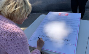 Photo of NYBRA signing the proclamation at the Go Pink Long Island event to kick off Breast Cancer Awareness Month on Oct. 1, 2021